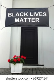 A Black Lives Matter banner hangs on the front porch of a church