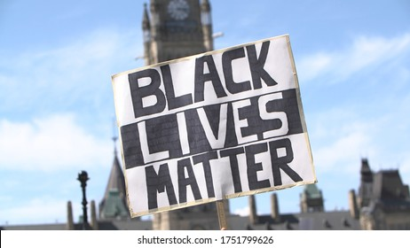 Black lives matter sign in front of Canada's parliament hill during the 2020 protests