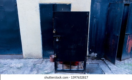 black lock box in an alleyway