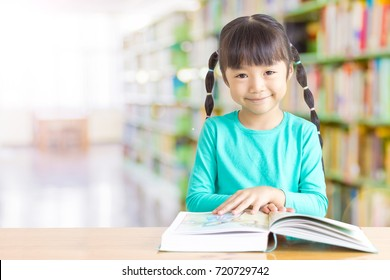 Black long hair kid is smiling, she like to read.