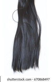 Black long hair on a white background