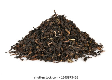 Black loose indian dry tea from Assam. Closeup macro high resolution isolated on white background top view.