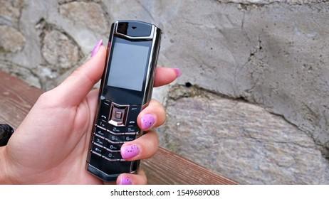 Black luxury phone in the hand