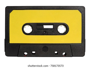 black magnetic tape cassette for analog audio music recording with yellow label isolated over white background
