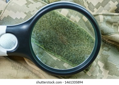 black magnifier  increases green velcro on spotty clothes