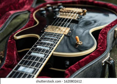 Black mahogany electric vintage single cut guitar with golden humbuckers and ebony fingerboard custom shop
