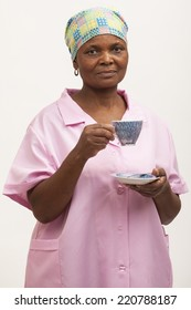 Black maid holding a cup of tea