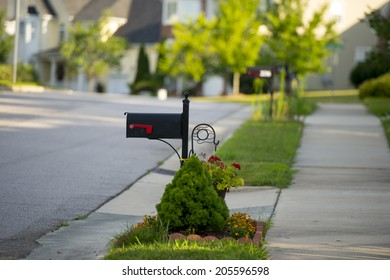 Black Mail Box in Front of a House