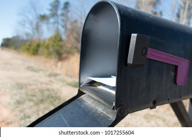 black mail box and post office mail with blue sky