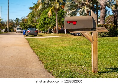 Black mailbox in front of a house.