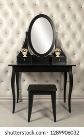 Black makeup mirror vanity with leather wall