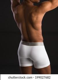 Black Male Wearing White Underwear on Dark Background