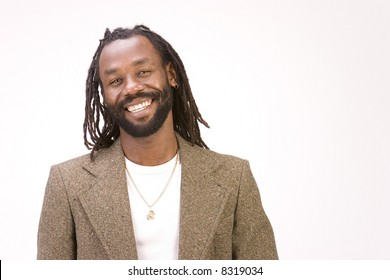 A black man with dreadlock hair isolated on a white background.