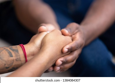 Black man friend holding hands of african woman, american family couple give psychological support, help trust care empathy hope in marriage relationships, comfort honesty concept, close up view
