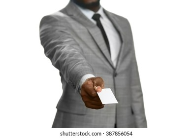 Black man handing visit card. Just in case. Call me any time. Brief info.