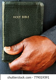 black man holding a bible after having service at a Sunday school stock photo