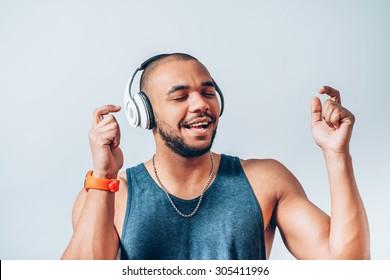 black man listening to music on headphones