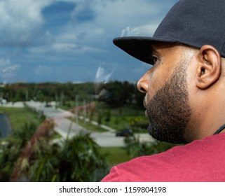 Black man looking out of a window
