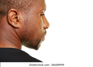 Black man looking pensive to the side