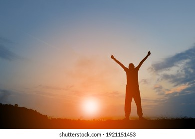 Black man standing with two arms up