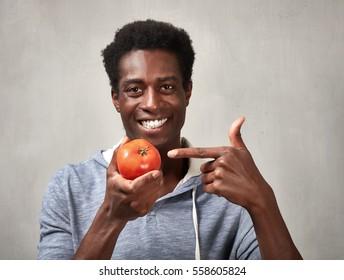 Black man with tomato.