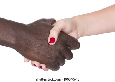 Black man and white woman shaking hands