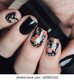 Black manicure with floral print