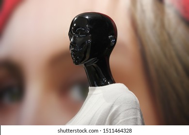 Black Mannequin On Background Of Photograph With Eyes