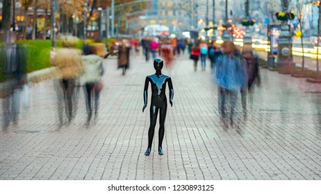 The black mannequin standing in a people crowd outdoor