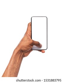 Black man's hand holding and touching blank smartphone screen with thumb, isolated on white background
