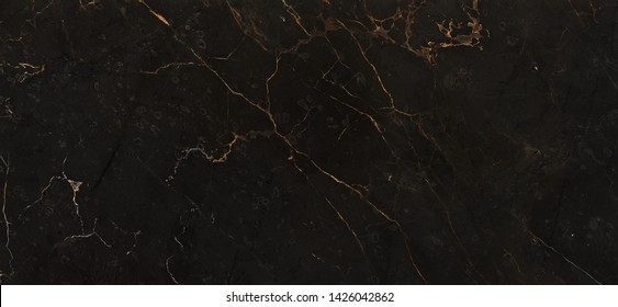 Black marble background with yellow veins. natural marble texture, dark brown marble background