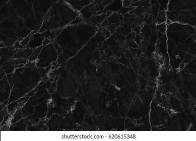 Black marble texture shot through with subtle white veining (Natural pattern for backdrop or background, Can also be used for create surface effect to architectural slab, ceramic floor and wall tiles)