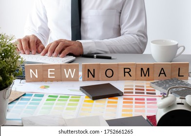 Black marble Tile. Materials construction on the table. New Normal Text on the work table. Businessman working in new normal space. Blur Asian man . the new mormal text.