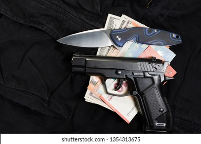 Black market weapons. Sale of illegal weapons. Top view of the money and weapons.