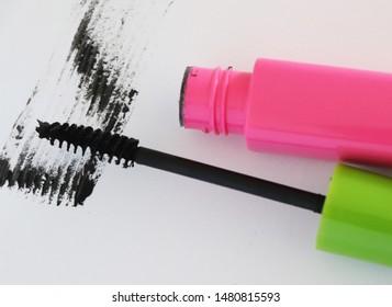 Black mascara brush stroke with applicator brush isolated on white, Black mascara mockup with brush,Set of make-up cosmetic mascara brush stroke texture design, Mascara eyelashes on white background