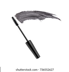 Black mascara brush stroke with applicator brush  isolated on white