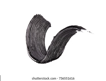 Black mascara brush strokes isolated on white