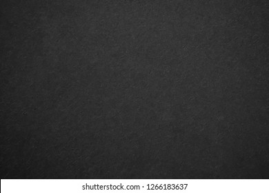 Black matte canvas with small abstract pattern detail textured background.