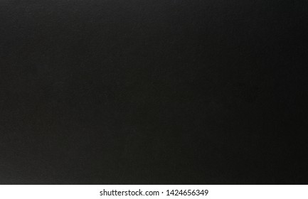 Black matte paper background close up view