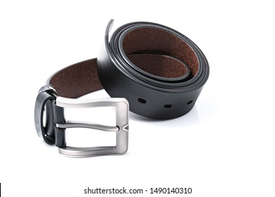 Black men's leather belts men's elegance trend on round shape with a white background. Fashion concept.