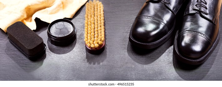 black men's shoes with care accessories, banner