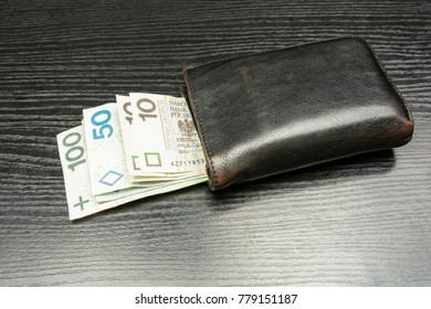 Black men's wallet with banknotes being a means of payment in Poland or Polish Zloty.
