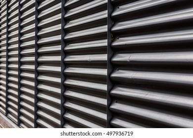 Black metal container door roll gate texture.