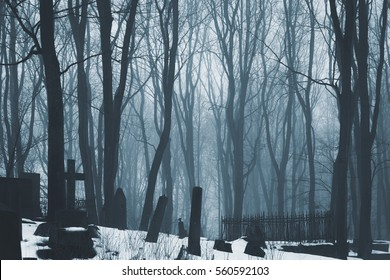 Black metal and dark ambient music album cover. Abandoned cemetery. Eternal winter.  Winter colors. Atmosphere of solitude, fear and depression. Loneliness and melancholy. Dreamland of winter.
