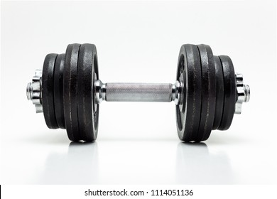 Black metal dumbbells on white background with clipping path (without a shadow).