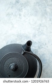 Black metal oriental traditional teapot isolated stone background. Top view with copy space.