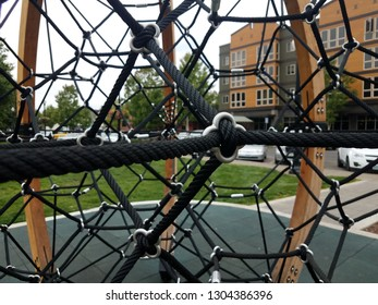 black metal rope climbing structure at playground
