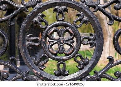 Black metal round -shaped symmetrical segment of a fence with tracery