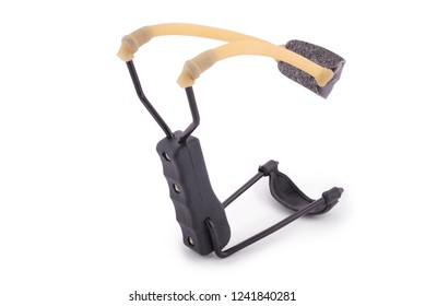 Black metal slingshot with a yellow rubber band isolated on white
