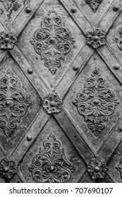 Black metal texture floral pattern background. Forging. Fasteners. The vertical frame.